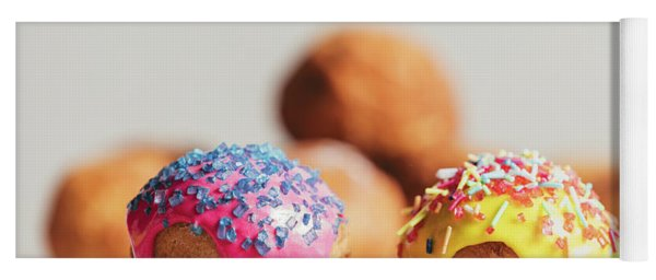 Two Decorated Doughnuts Laying On A Table. Yoga Mat