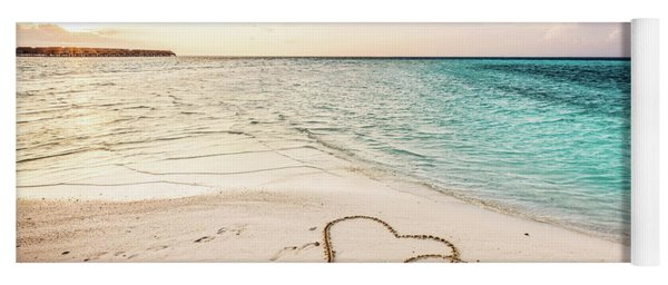 Two Hearts Drawn On A Sandy Beach By The Sea. Yoga Mat