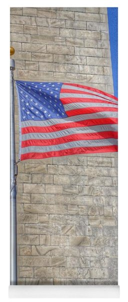 Yoga Mat featuring the photograph Washington Monument With The American Flag by Marianna Mills