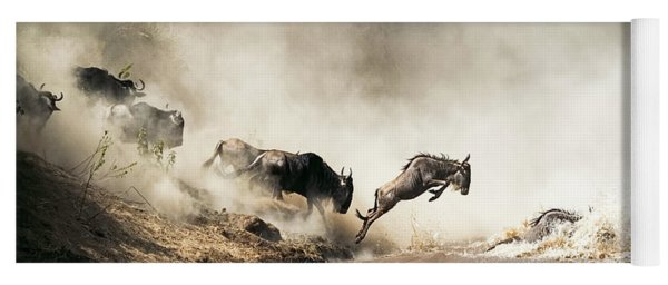 Wildebeest Leaping In Mid-air Over Mara River Yoga Mat