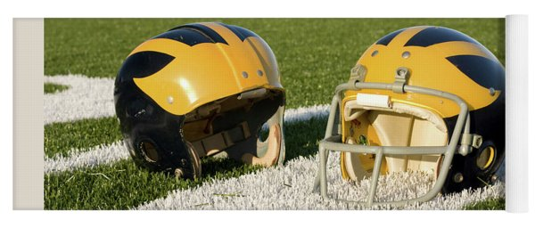 Wolverine Helmets From Different Eras On The Field Yoga Mat