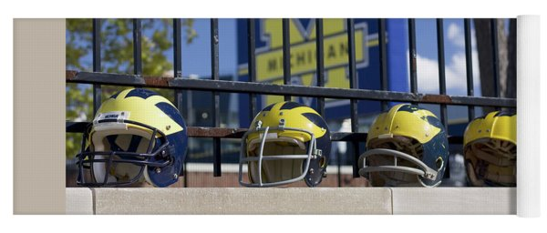 Yoga Mat featuring the photograph Wolverine Helmets Of Different Eras On Stadium Wall by Michigan Helmet