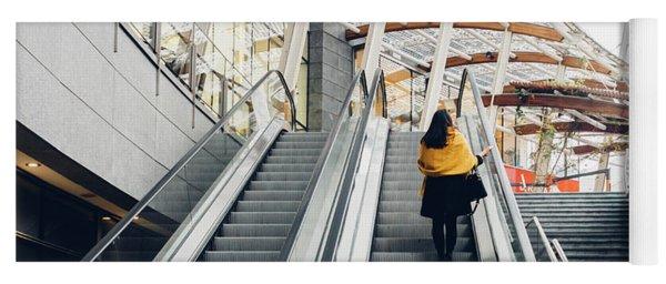 Woman Going Up Escalator In Milan, Italy Yoga Mat
