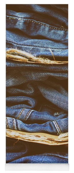 Women's Jeans Folded In A Pile On A Colored Background. Made In A Vintage Performance. Yoga Mat