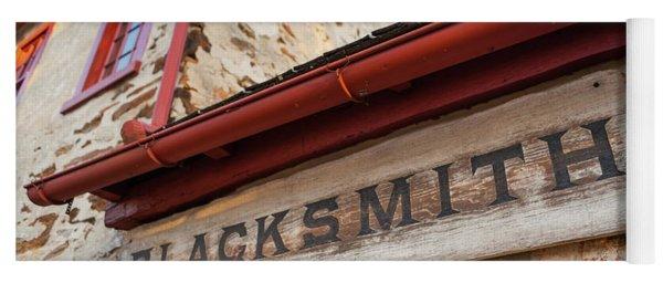 Wood Blacksmith Sign On Building Yoga Mat