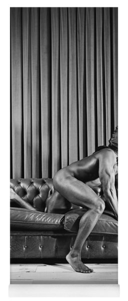 Beautiful Naked Man With Mask Posing On A Sofa Yoga Mat
