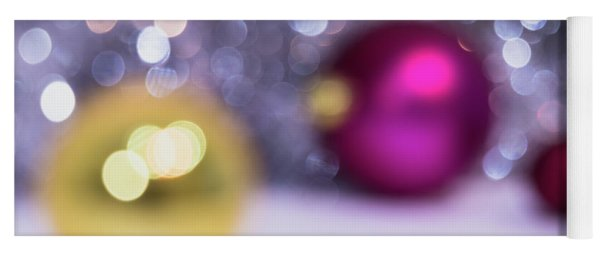 Yoga Mat featuring the photograph Blurry Christmas Background With Christmas Balls And Bokeh by Cristina Stefan