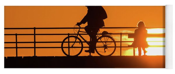 Cyclist Silhouetted At Sunset Yoga Mat