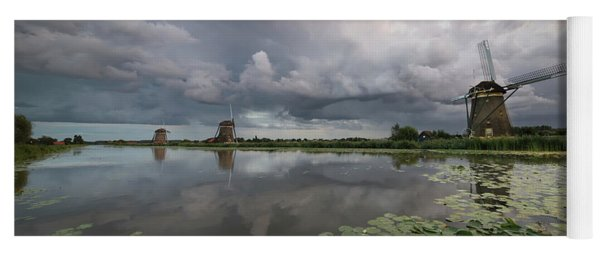 Yoga Mat featuring the photograph Dramatic Sky Over Three Windmills In Holland by IPics Photography