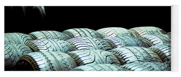 Old Tires And Racing Wheels Stacked In The Sun Yoga Mat