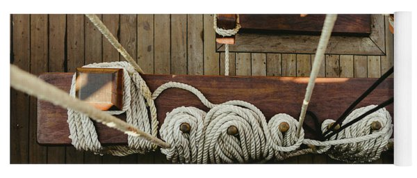 Ropes To Hold The Sails Of An Old Sailboat Rolled. Yoga Mat