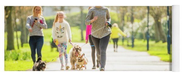 Running With Her Dog In The Park Yoga Mat