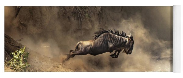 Wildebeest Leaps From The Bank Of The Mara River Yoga Mat