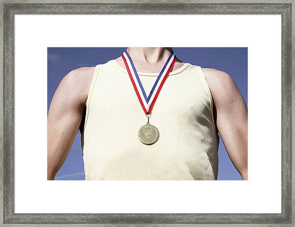 . Athlete With Gold Medal Framed Print by Tom and Steve