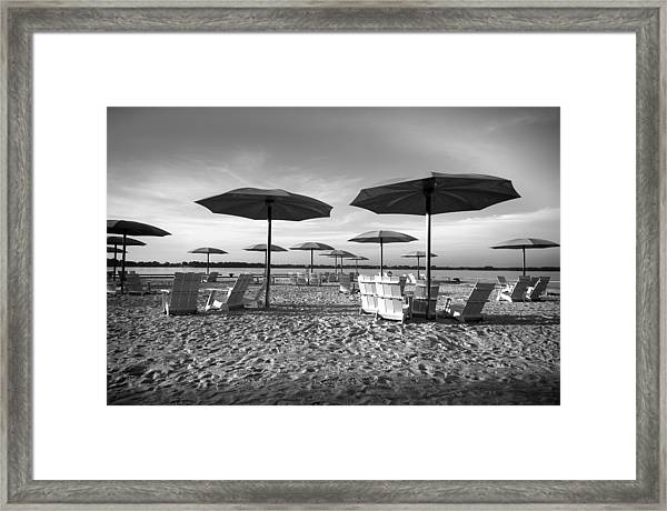 Umbrellas On The Beach Framed Print