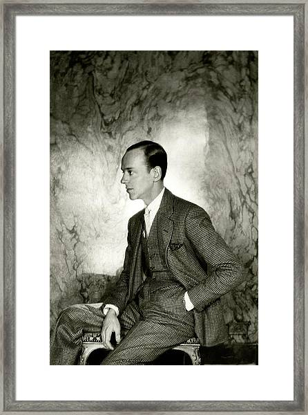 A Portrait Of Fred Astaire Sitting Framed Print by Cecil Beaton