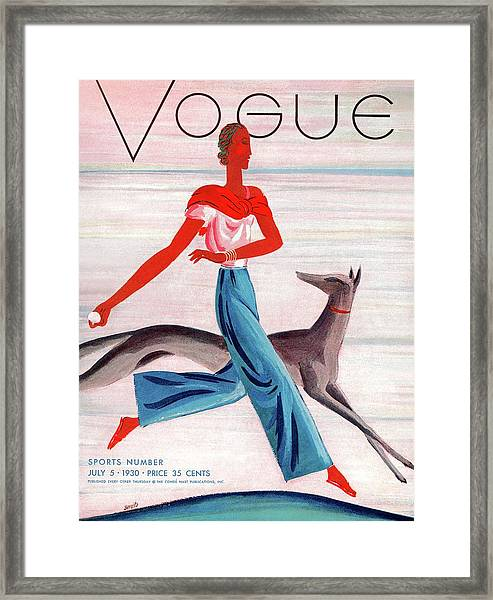 A Vintage Vogue Magazine Cover Of An African Framed Print