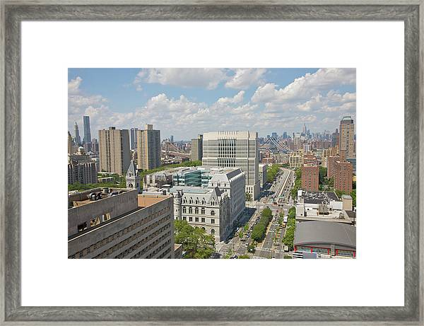 Aerial View Of Rooftops And City Skyline Framed Print