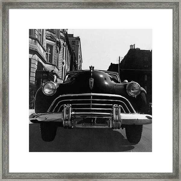 An Oldsmobile Car Framed Print
