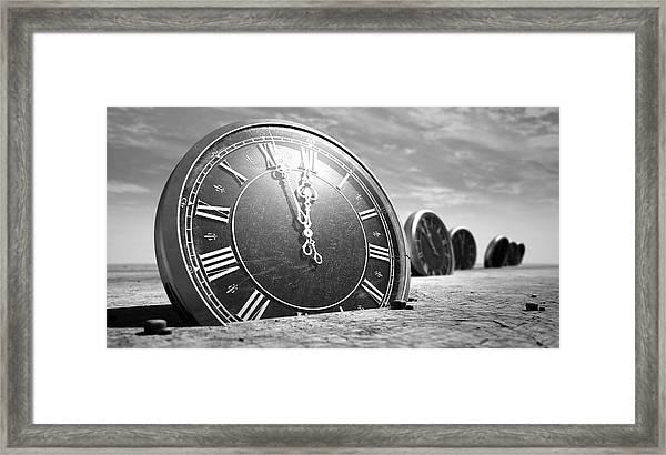 Antique Clocks In The Desert Sand Framed Print