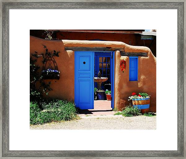 Framed Print featuring the photograph Behind A Blue Door 1 by Mel Steinhauer