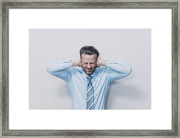 Business Man Covering His Ears. Framed Print by Guido Mieth