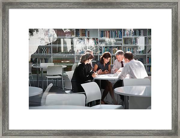 Businesspeople In Office Meeting Framed Print by Tom Merton