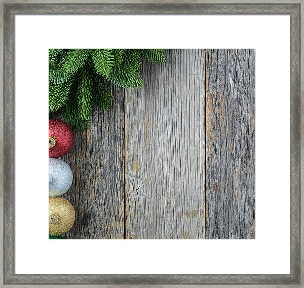 Christmas Pine Needle And Ornaments On A Rustic Wood Background Framed Print