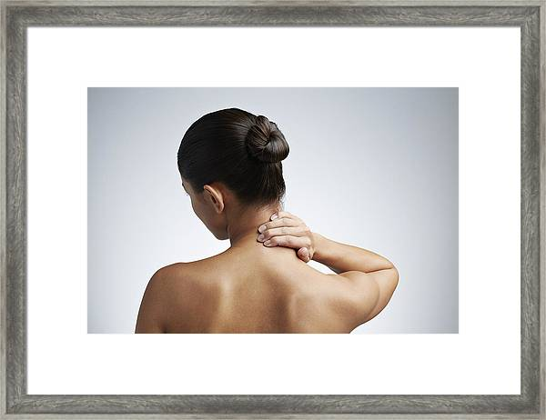 Close Up Of Woman Having Neck Pain Framed Print by Klaus Vedfelt