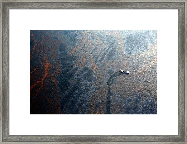 Coast Guard Attempts Burning Off Oil Leaking From Sunken Rig Framed Print by Chris Graythen