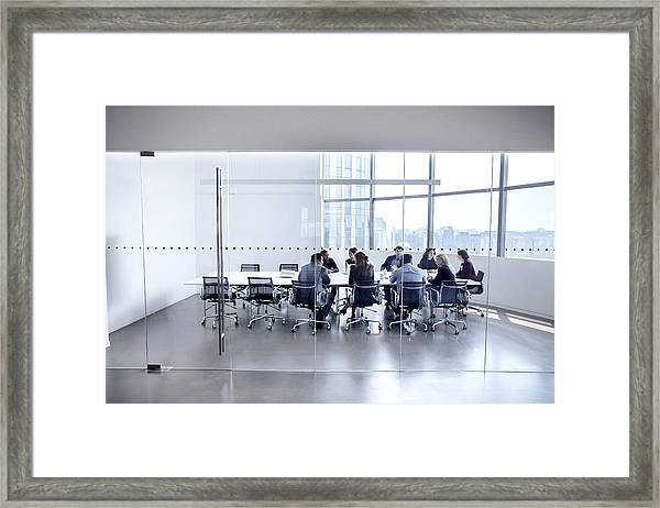 Colleagues At Business Meeting In Conference Room Framed Print by FangXiaNuo