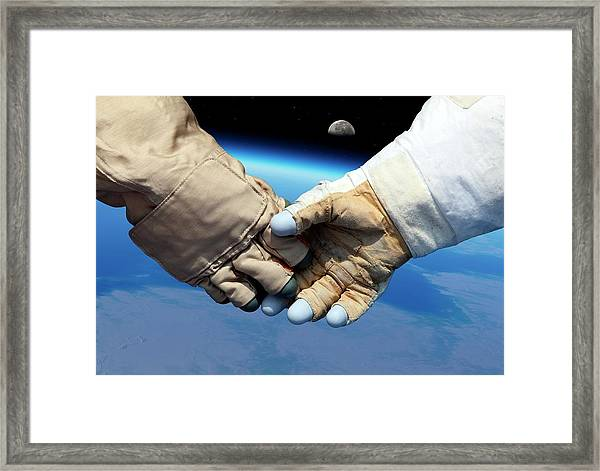 Cosmonaut And Astronaut Shaking Hands Framed Print