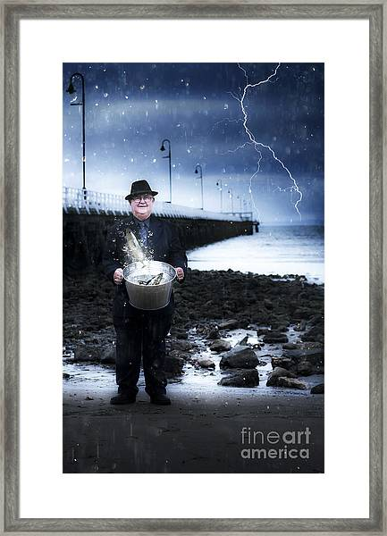 Elderly Fisherman Holding A Bucket Of Fish Framed Print