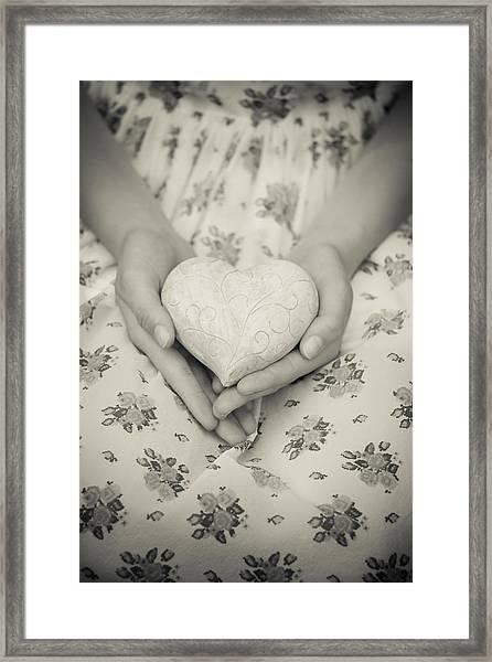 Hands Holding A Heart Framed Print