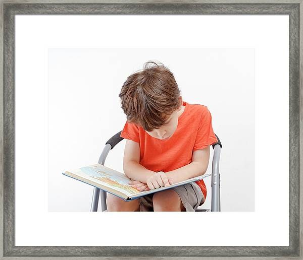 Investigative Young Boy Of Six Framed Print