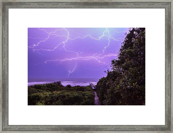 Lightning Over The Beach Framed Print