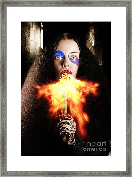 Medieval Jester Breathing Fire During Carnival Act Framed Print