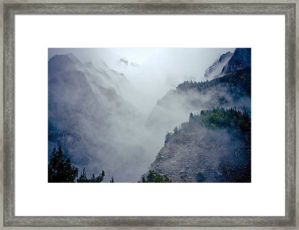 Framed Print featuring the photograph Mist In Mountain Mystery Forest by Raimond Klavins