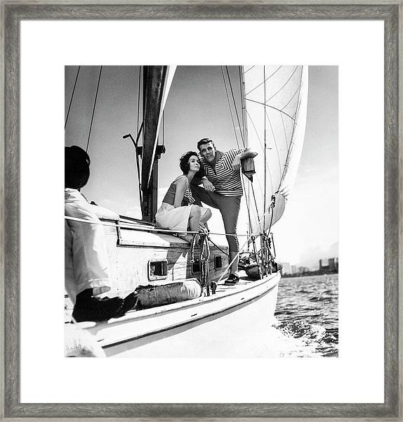 Models On A Sailboat Framed Print