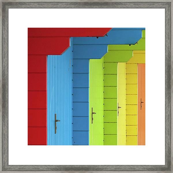 Multi-coloured Beach Huts Framed Print