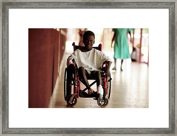 Patient In A Wheelchair Framed Print by Mauro Fermariello/science Photo Library