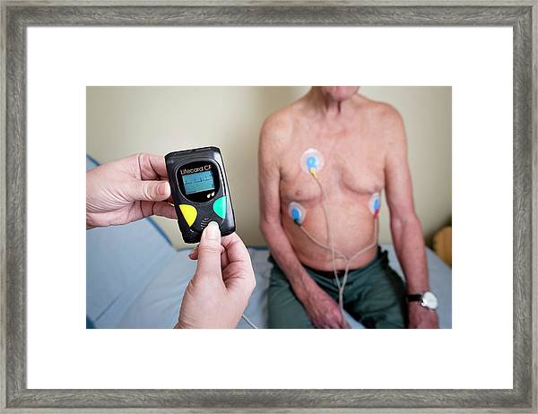 Portable Ecg Monitor Being Fitted Framed Print