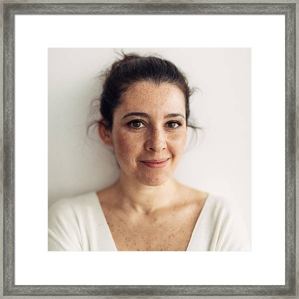 Portrait Of A Smiling Young Woman Framed Print by AleksandarNakic