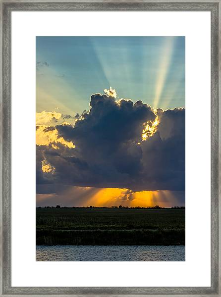 Rays From The Clouds Framed Print