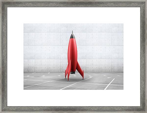 Rocket In Parking Lot Framed Print