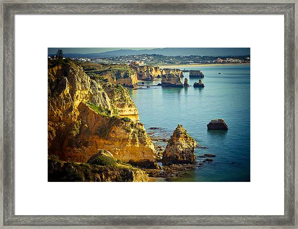 Framed Print featuring the photograph Rocky Coast And Sea At Background by Raimond Klavins