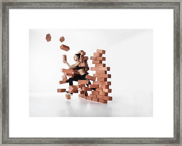 Runner Shattering Barrier Framed Print by Henrik Sorensen