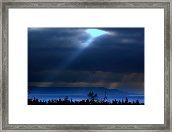 Shining A Light Over The Bay Framed Print