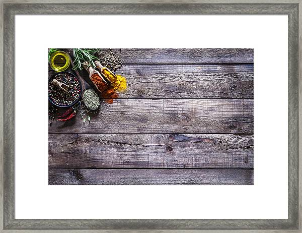 Spices And Herbs On Rustic Wood Kitchen Table Framed Print by Fcafotodigital