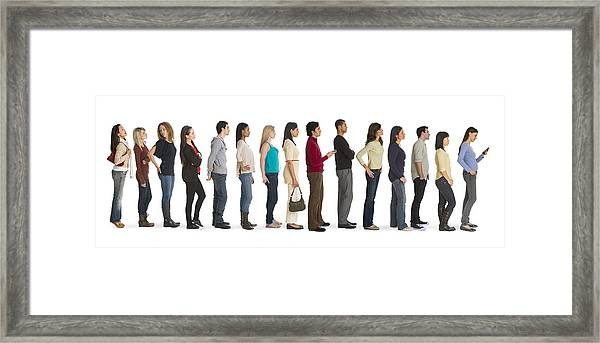 Studio Shot Of People Waiting In Line Framed Print by Tetra Images